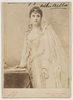 """Nellie Melba, in costume for """"Lucia di Lammermoor"""", posed to sign the marriage certificate, ca. 1888 / photographer Nadar, rue d'Anjou, St. Honore, 51, Paris"""