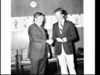 """Amatil (cigarette and soft drink company) presents a cheque to Tom Lingwood at Amatil House for his designs for """"War and peace"""", the inaugural opera which opened the Sydney Opera House"""