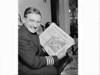 Captain Mervyn Jones (aviator) shows the headline of the Sydney Morning Herald for Wednesday 21 February 1962 detailing the orbit of John Glenn, (to whom he had spoken), around the Earth